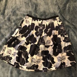 The Limited Cream with black/blue design skirt.